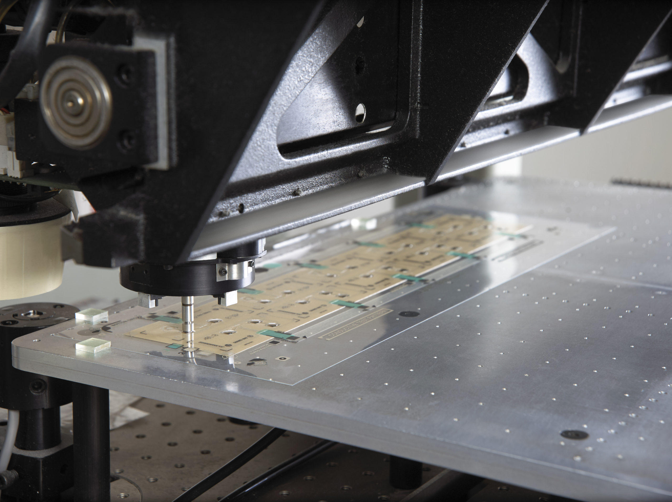 Automated machinery placing a domed component